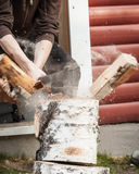 Wood chopping with hand axe Stock Images