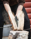 Wood chopping with hand axe Stock Photography