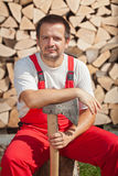 Wood chopping worker having a break Royalty Free Stock Image