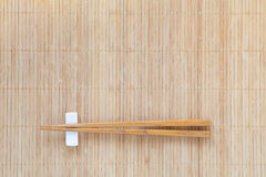 Wood chopsticks on brown bamboo met Stock Photo