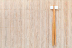 Wood chopsticks on brown bamboo met Royalty Free Stock Photos
