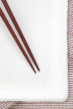 Wood chopsticks and white ceramic plate. Brown wood chopsticks and white ceramic plate Stock Image