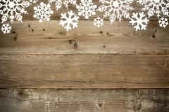 Wood Christmas background with snowflakes. Wooden Christmas background with shiny snowflake top border Royalty Free Stock Photos
