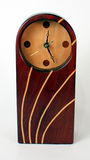 Wood Clock. Red mahogany and white maple clock on white background Royalty Free Stock Photography