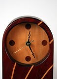 Wood Clock. Close-up of a Red mahogany and white maple clock  on a white background Stock Photos