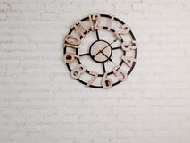 Wood clock on white brick wall Stock Images