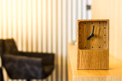 Wood clock on worktable Royalty Free Stock Photos