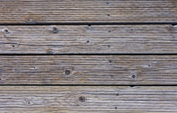 Wood Close Up. Close up of weathered wood on a boardwalk. Photographed in natural light.  Image has copy space Royalty Free Stock Images