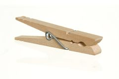 Wood clothespin. Generic, wooden clothespin, isolated against white ground stock photography