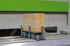 Wood cnc. Block of wood at cnc machine Stock Photo