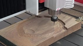 Wood CNC engraving and cutting machine stock video