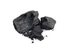Wood Coal. Piece of fractured wood coal isolated over white background Stock Photos