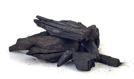 Wood coal. Piece of fractured wood coal isolated over white background Royalty Free Stock Images