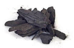 Wood coal. Piece of fractured wood coal isolated over white background Royalty Free Stock Photo