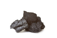 Wood coal. Piece of fractured wood coal isolated over white Royalty Free Stock Photo