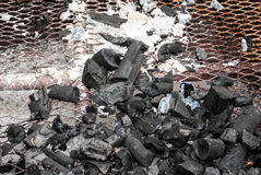Wood Coal with Ash on Grate Royalty Free Stock Images