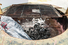 Wood Coal with Ash on Grate in Fireplace Royalty Free Stock Photo