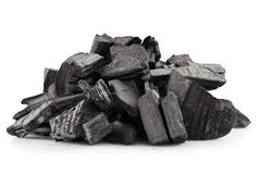 Wood coal. Piece of fractured wood coal isolated over white background Stock Image