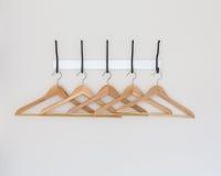 Wood coat hanger Stock Images