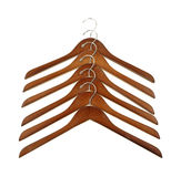 Wood coat hangers in row Stock Photo
