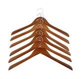Wood coat hangers in row Stock Photo
