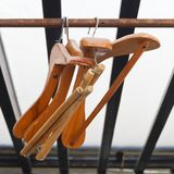 Wood Coat Hangers on Rustic Clothes Rack Stock Image