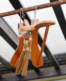 Wood Coat Hangers on Rustic Clothes Rack Royalty Free Stock Photography
