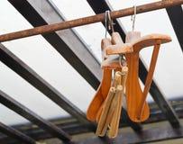 Wood Coat Hangers on Rustic Clothes Rack Stock Photos