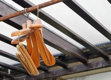 Wood Coat Hangers on Rustic Clothes Rack Royalty Free Stock Image