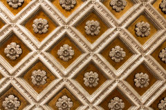 Wood coffered ceiling. Antique wooden ornamentet ceiling with gold stock photos