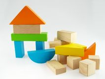 Wood color toy blocks. On the white background Royalty Free Stock Image