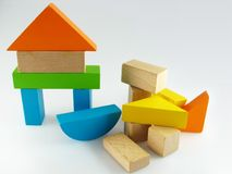 Wood color toy blocks. On the white background Royalty Free Stock Photography