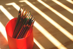 Wood colored pencils. Photograph of some wood colored pencils on a wood table Stock Photography