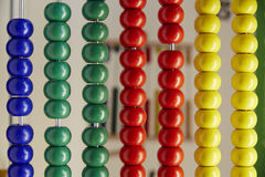 Wood colorful beads on the child abacus toy tool Royalty Free Stock Photos