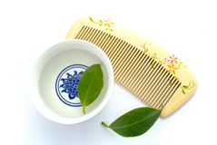Wood comb and herb tea Royalty Free Stock Image