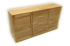 Wood commode. High quality, modernly designed with front and legs made in masive oak or beech wood Stock Photos