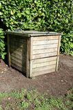 Wood compost bin in family garden. Home Royalty Free Stock Image