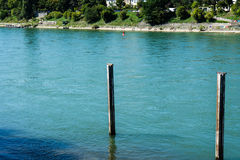 Wood construction in rhine river with blue water royalty free stock photo