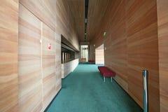 Wood corridor. Corridor, wood walls and green velvet carpet Royalty Free Stock Photo