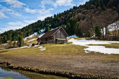 Wood cottage on foot of the hill Stock Image