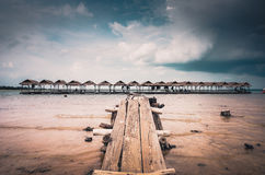 Wood cottage Water and sky in the Reservoir vintage Royalty Free Stock Photography