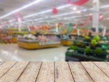 Wood counter product display with fruits shelves in supermarket Stock Image