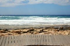 Wood countertops on the blue sea & sky background. A Wood countertops on the blue sea & sky background Stock Photos