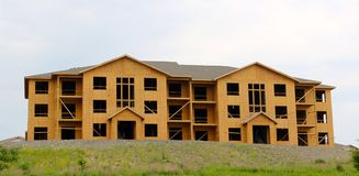 Wood Covered Frame of a Hotel Under Construction. Wood Covered Frame skeleton of a hotel under construction outside Memphis Tennessee in a new subdivision Stock Photo