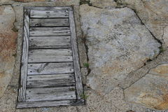 Wood and cracked stone walkway Royalty Free Stock Photography