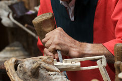 Wood craftsman. A craftsman carving the wood Royalty Free Stock Image