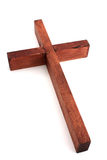 Wood Cross. Red Wood cross against a white background Stock Photo