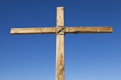 Wood Cross. Wooden Cross on Blue Sky Background stock image
