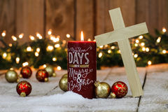 Wood cross, candle and holiday decorations Stock Photography