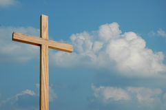 Wood Cross and Clouds. Wood Cross on blue sky and clouds royalty free stock photo